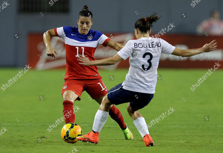United States defender Ali Krieger (11) controls the ball in front of France defender Laure Boulleau (3) during the first half of a women's friendly soccer match, in Tampa, Fla