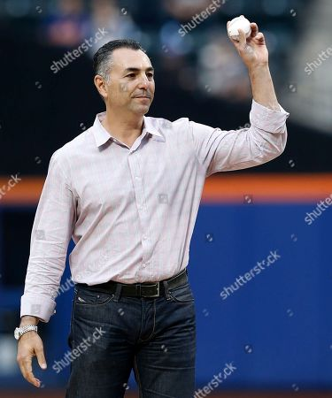 John Franco Former New York Mets relief pitcher John Franco, holds the ball up before throwing out the ceremonial first pitch before a baseball game against the New York Yankees in New York