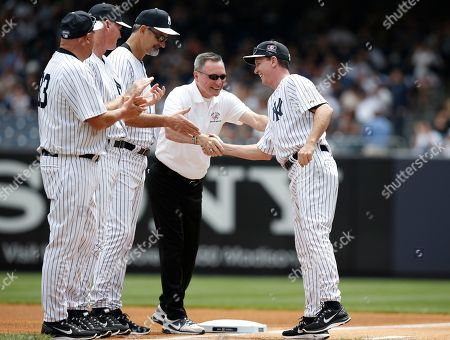 Graeme Lloyd, Gene Monahan, David Cone Former Yankees trainer Gene Monahan, center, greets former Yankees pitcher David Cone, right, during introductions for the Yankees 68th annual Old-Timers Day prior to the Baltimore Orioles baseball game against the New York Yankees at Yankee Stadium in New York, . Former Yankees pitcher Graeme Lloyd of Australia is to the left of the pair