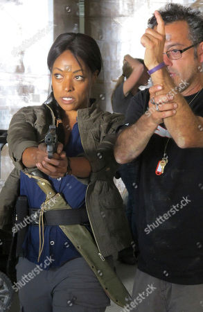 """Actress Kellita Smith, left, rehearses a scene from the new television series """"Z Nation'"""" in Spokane, Wash. The latest entry into the growing catalog of zombie stories in the entertainment world, the new television series """"Z Nation,"""" is in the midst of filming its 13-episode first season in northeast Washington state"""