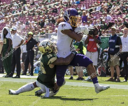 South Florida Bulls defensive back Nate Godwin (36) tackles East Carolina Pirates wide receiver Zay Jones (7) before he can get into the end zone after the catch and big gain in the 3rd quarter in the game between East Carolina Pirates and the South Florida Bulls at Raymond James Stadium in Tampa, Florida