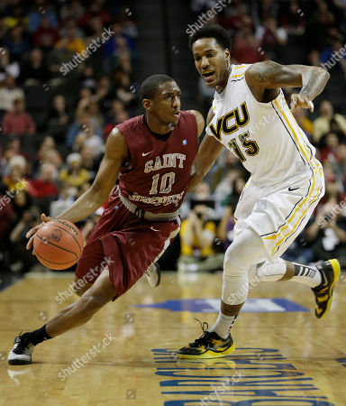 Langston Galloway, Juvonte Reddic Saint Joseph's Langston Galloway, left, moves past VCU's Juvonte Reddic during the first half of an NCAA college basketball game in the championship round of the Atlantic 10 Conference tournament at the Barclays Center in New York