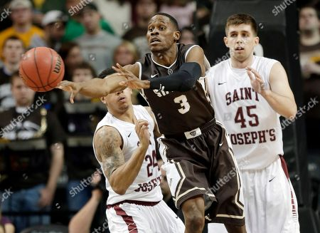 Charlon Kloof, Chris Wilson, Halil Kanacevic St. Bonaventure's Charlon Kloof, center, passes the ball in front of Saint Joseph's Chris Wilson, left, and Halil Kanacevic during the second half of an NCAA college basketball game in the semifinal round of the Atlantic 10 Conference tournament at the Barclays Center in New York, . Saint Joseph's defeated St. Bonaventure 67-48