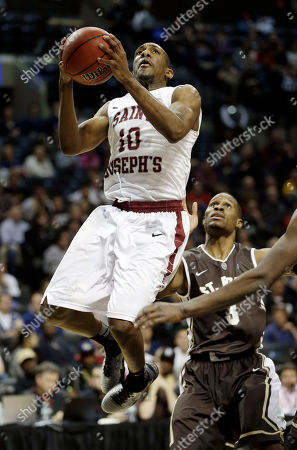 Langston Galloway, Charlon Kloof Saint Joseph's Langston Galloway, left, drives to the basket while St. Bonaventure's Charlon Kloof looks on during the second half of an NCAA college basketball game in the semifinal round of the Atlantic 10 Conference tournament at the Barclays Center in New York, . Saint Joseph's defeated St. Bonaventure 67-48