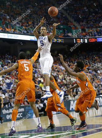 Rodney Hood, Jaron Blossomgame, Austin Ajukwa Duke's Rodney Hood, center, passes the ball over Clemson's Jaron Blossomgame, left, and Austin Ajukwa, right, during the first half of a quarterfinal NCAA college basketball game at the Atlantic Coast Conference tournament in Greensboro, N.C