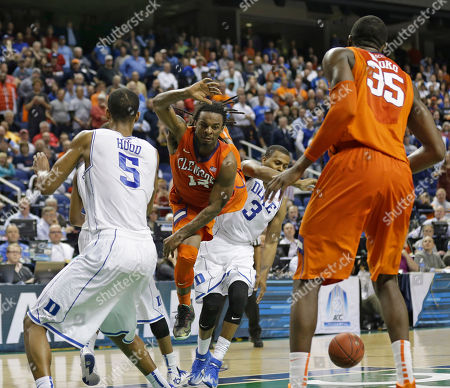 Rod Hall, Rodney Hood, Tyler Thornton Clemson's Rod Hall (12) loses the ball as he drives between Duke's Rodney Hood (5) and Tyler Thornton (3) as time expires in an NCAA college basketball game in the quarterfinals of the Atlantic Coast Conference men's tournament in Greensboro, N.C., . Duke won 63-62