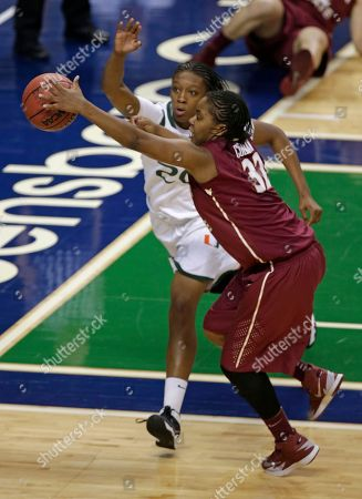 Stock Picture of Lauren Coleman, Keyona Hayes Florida State's Lauren Coleman (32) and Miami's Keyona Hayes (20) chase a loose ball during the second half of an NCAA college basketball game at the Atlantic Coast Conference tournament in Greensboro, N.C., . Florida State won 72-67 in overtime
