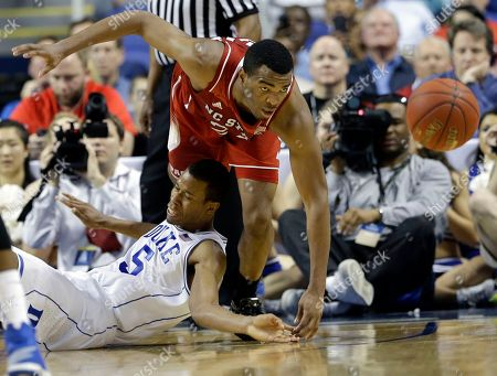 T.J. Warren, Rodney Hood North Carolina State's T.J. Warren, top, and Duke's Rodney Hood, bottom, chase a loose ball during the second half of an NCAA college basketball game in the semifinals of the Atlantic Coast Conference tournament in Greensboro, N.C., . Duke won 75-67