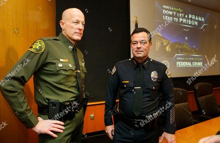 "Mike Hiller, Michael Hyams Orange County Sheriff captain, Mike Hiller, of John Wayne Airport operations, left, talks with Los Angeles World Airports Police Assistant Chief Michael Hyams Office of Operations, joins law enforcement agents to announce a 60-day FBI campaign ""Don't Let a Prank Lead to Prison, Aiming a Laser at an Aircraft is a Federal Crime,'' to publicize the problem of pointing lasers to aircraft, at a news conference at the Los Angeles International airport . The FBI announced that it will offer rewards up to $10,000 for people who report others for shining laser pointers at aircraft. A handheld laser can temporarily blind pilots who sometimes need to depend on their vision for orientation"