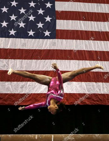 Elizabeth Price Elizabeth Price performs on the beam during the American Cup gymnastics competition in Greensboro, N.C., . Price won the women's overall title