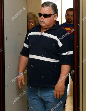 Gene Jones Gene Jones, the father of Michael Jones, walks through a metal detector to enter the courtroom for a hearing in Duncan, Okla, . Michael Jones is charged in the murder of Australian Christopher Lane