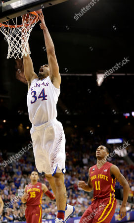 Perry Ellis Kansas' Perry Ellis gets past Iowa State's Monte Morris (11) and Naz Long (15) to dunk the ball during the first half of an NCAA college basketball game in the Big 12 men's tournament, in Kansas City, Mo