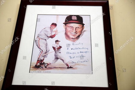 A framed and signed picture from Stan Musial hangs on a wall at Dusty Baker's home in Granite Bay, Calif. Out of uniform for the first time since taking 2007 off between managerial jobs with the Cubs and Reds, Baker is not slowing down much from his pressure-packed days in the dugout