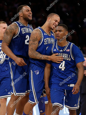 Sterling Gibbs, Brian Oliver, Gene Teague Seton Hall's Sterling Gibbs, right, celebrates with teammates Brian Oliver, center, and Gene Teague after he sunk the winning basket during the second half of an NCAA men's college basketball game against Villanova in the second round of the Big East tournament at Madison Square Garden, in New York. Seton Hall defeated Villanova 64-63