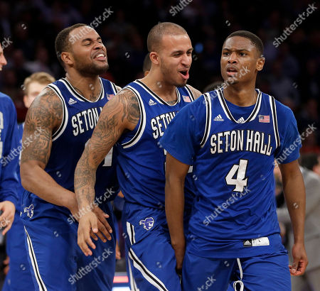 Sterling Gibbs, Brian Oliver, Gene Teague Seton Hall's Sterling Gibbs, right, celebrates with teammates Brian Oliver, center, and Gene Teague after he sunk the game-winning basket during the second half of an NCAA college basketball game against Villanova in the second round of the Big East Conference tournament at Madison Square Garden, in New York. Seton Hall defeated Villanova 64-63