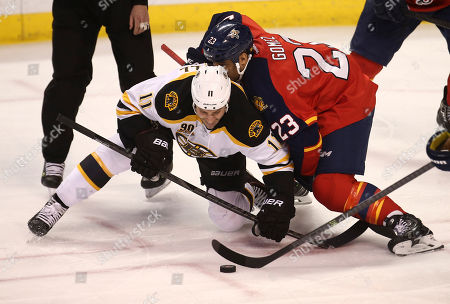 Gregory Campbell, Scott Gomez Boston Bruins' Gregory Campbell (112) and Florida Panthers' Scott Gomez (23) battle for the puck during the third period of an NHL hockey game in Sunrise, Fla., . Boston won 5-2