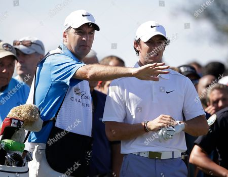 Stock Photo of J P Fitzgerald, Rory McIlroy Rory McIlroy, right, and his caddie J P Fitzgerald look at his shot from the fourth fairway during the second round of the Cadillac Championship golf tournament, in Doral, Fla
