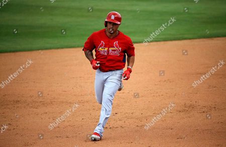 Kolten Wong St. Louis Cardinals' Kolten Wong rounds the bases after hitting a two-run home run to score teammate Stephen Piscotty in the seventh inning of an exhibition spring training baseball game against the New York Mets, in Port St. Lucie, Fla