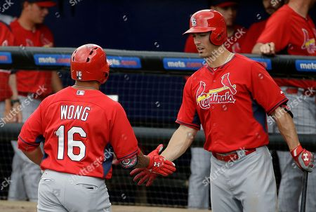 Kolten Wong St. Louis Cardinals' Kolten Wong, left, is high-fived by teammate Randal Grichuk after hitting a two-run home run to score teammate Stephen Piscotty in the seventh inning of an exhibition spring training baseball game against the New York Mets, in Port St. Lucie, Fla