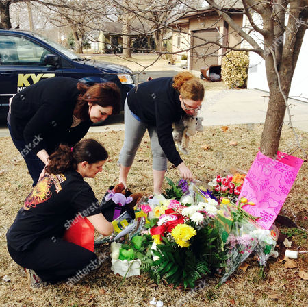 Stacey Barfield Stacey Barfield, mother of Hailey Owens, kneeling, and family members Sara Wells, left, and Teri Nord arrange flowers left by well wishers near the site where the 10-year-old girl was abducted just blocks from the Springfield, Mo., home. Prosecutors have charged Craig Michael Wood with first-degree murder, kidnapping and armed criminal action in their girls death. Prosecutors says the fourth-grader's body was found stuffed in two trash bags inside plastic storage containers in the basement of Wood's Springfield home. She had been shot in the head