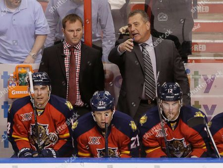 Stock Picture of Peter Horachek, John Madden Florida Panthers Interim Head Coach Peter Horachek, right rear, talks with Assistant Coach John Madden during the first period of an NHL hockey game against the Phoenix Coyotes, in Sunrise, Fla