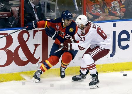 Mike Ribeiro, Scott Gomez Florida Panthers center Scott Gomez (23) and Phoenix Coyotes center Mike Ribeiro (63) battle for the puck during the third period of an NHL hockey game, in Sunrise, Fla. The Coyotes defeated the Panthers 3-1