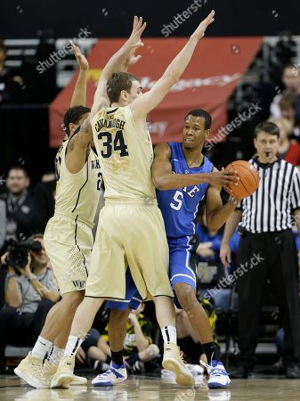 Miles Overton, Tyler Cavanaugh, Rodney Hood Duke's Rodney Hood (5) is trapped by Wake Forest's Tyler Cavanaugh (34) and Miles Overton (20) during the first half of an NCAA college basketball game in Winston-Salem, N.C