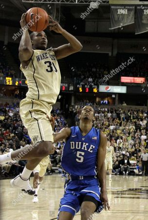 Andre Washington, Rodney Hood Wake Forest's Andre Washington (31) drives past Duke's Rodney Hood (5) during the second half of an NCAA college basketball game in Winston-Salem, N.C., . Wake Forest won 82-72