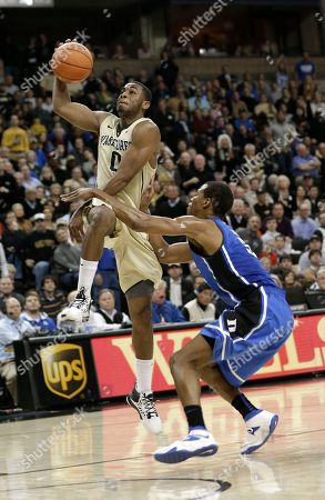 Codi Miller-McIntyre, Rodney Hood Wake Forest's Codi Miller-McIntyre, left, drives against Duke's Rodney Hood, right, during the first half of an NCAA college basketball game in Winston-Salem, N.C
