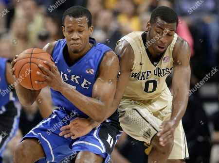 Rodney Hood, Codi Miller-McIntyre Duke's Rodney Hood, left, grabs the ball as Wake Forest's Codi Miller-McIntyre, right, defends during the first half of an NCAA college basketball game in Winston-Salem, N.C