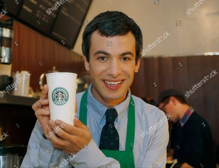 """Nathan Fielder Canadian comedian Nathan Fielder of the Comedy Central show """"Nathan For You"""" poses with a cup as he comes forward as the brainchild of """"Dumb Starbucks,"""" a parody store that resembles a Starbucks with a green awning and mermaid logo, but with the word """"Dumb"""" attached above the Starbucks sign. Starbucks Coffee spokeswoman, Laurel Harper says the store is not affiliated with Starbucks and, despite the humor, the store cannot use the Starbucks name"""