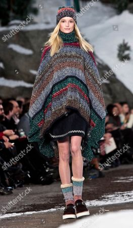 Stock Image of Tommy Hilfiger Fashion from the Tommy Hilfiger Fall 2014 collection during New York Fashion Week. Lucky magazine style editor Laurel Pantin says trends for cooler weather include baby blue outerwear, shearling coats, oversized sweaters, plaids, black-and-white prints, straight trouser pants, hiking boots, blanket coats and Pendleton prints