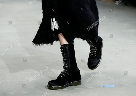 An item from the Fall 2014 Calvin Klein collection during Fashion Week in New York. Lucky magazine style editor Laurel Pantin says trends for cooler weather include baby blue outerwear, shearling coats, oversized sweaters, plaids, black-and-white prints, straight trouser pants, hiking boots, blanket coats and Pendleton prints