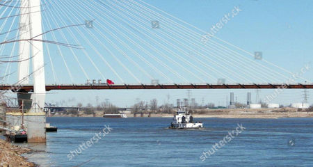Stock Photo of A tugboat travels along the Mississippi River near the Stan Musial Veterans Memorial Bridge on . The Mississippi River is currently running low, and experts say that despite all the snow melt that will be coming this spring, there is little likelihood of significant flooding in the Midwest