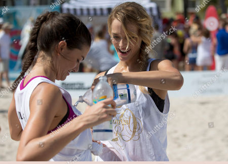 Stock Photo of Hannah Ferguson, Lauren Mellor Sports Illustrated swimsuit model Hannah Ferguson, right, pours water over Lauren Mellor after the two finished a volleyball game alongside celebrity chefs in a charity beach volleyball tournament, on South Beach in Miami Beach, Fla. The chefs, who paid at least $1,000 each for the privilege of playing alongside the models, hit the sand as part of the South Beach Wine and Food Festival. The event raised more than $20,000 for the Armed Forces Foundation and featured models from the 50th anniversary edition of the Sports Illustrated Swimsuit Issue