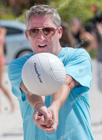 Tim Love Tim Love warms up before a match as a dozen Sports Illustrated swimsuit models and celebrity chefs tested their mettle in a charity beach volleyball tournament, on South Beach in Miami Beach, Fla. The chefs, who paid at least $1,000 each for the privilege of playing alongside the models, hit the sand as part of the South Beach Wine and Food Festival. The event raised more than $20,000 for the Armed Forces Foundation and featured models from the 50th anniversary edition of the Sports Illustrated Swimsuit Issue