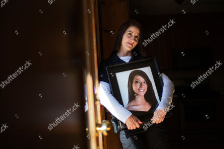 """Tanya Smith Tanya Smith holds a portrait of her daughter Taylor in her home, in Holly Springs, Ga. Smith, a Georgia police officer who oversees criminal investigations, is no stranger to battling the perils of drug abuse. Yet Smith's current fight is personal, in memory of her 20-year-old daughter, Taylor, who died last year of a drug overdose after no one called 911 for help. Smith is among a group of parents lobbying on behalf of a bill that would grant amnesty from certain drug charges for those who seek medical attention in the event of a drug overdose. """"My daughter died because people were too afraid to dial 911,"""" said Smith, a lieutenant with the Holly Springs Police Department. """"This is taking that fear out of it"""