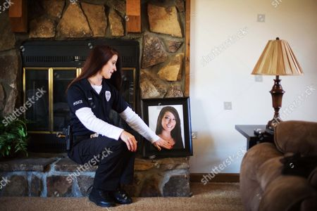 """Tanya Smith Tanya Smith touches the portrait of her daughter Taylor as she sits for a photo in her home, in Holly Springs, Ga. Smith, a Georgia police officer who oversees criminal investigations, is no stranger to battling the perils of drug abuse. Yet Smith's current fight is personal, in memory of her 20-year-old daughter, Taylor, who died last year of a drug overdose after no one called 911 for help. Smith is among a group of parents lobbying on behalf of a bill that would grant amnesty from certain drug charges for those who seek medical attention in the event of a drug overdose. """"My daughter died because people were too afraid to dial 911,"""" said Smith, a lieutenant with the Holly Springs Police Department. """"This is taking that fear out of it"""