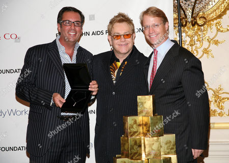 Harry Slatkin of President Home Design Limited Brands, Sir Elton John and CEO of Bath and Body Works Neil Fiske at the launch of the Elton John Fireside Holiday Collection available at Bath and Body Works, a portion of proceeds will benefit The Elton John Aids Foundation.