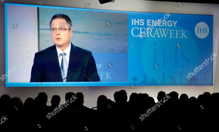 John Watson Attendees watch as Chevron chairman and CEO John Watson speaks at the IHS CERAWeek energy conference, in Houston