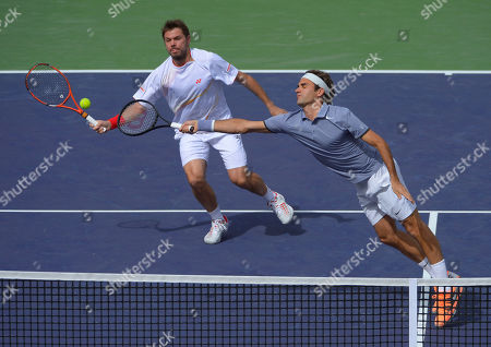 Roger Federer, Stanislas Wawrinka Roger Federer, of Switzerland, right, stretches for the ball as doubles partner Stanislas Wawrinka, of Switzerland, looks on during a match at the BNP Paribas Open tennis tournament against Rohan Bopanna, of India, and Aisam-Ul-Haq Qureshi, of Pakistan, in Indian Wells, Calif