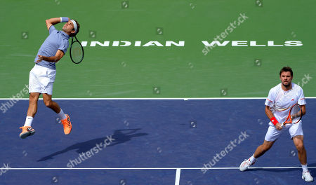 Roger Federer Roger Federer, of Switzerland, right, returns a volley during a match with doubles partner Stanislas Wawrinka, (not shown) at the BNP Paribas Open tennis tournament against Rohan Bopanna, of India, and Aisam-Ul-Haq Qureshi, of Pakistan, in Indian Wells, Calif