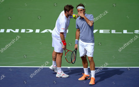 Roger Federer, Stanislas Wawrinka Roger Federer, of Switzerland, right, and doubles partner Stanislas Wawrinka, of Switzerland, talk during a match at the BNP Paribas Open tennis tournament against Rohan Bopanna, of India, and Aisam-Ul-Haq Qureshi, of Pakistan, in Indian Wells, Calif