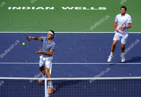 Roger Federer, Stanislas Wawrinka Roger Federer returns a volley as he and doubles partner Stanislas Wawrinka, both of Switzerland, play Rohan Bopanna, of India, and Aisam-Ul-Haq Qureshi, of Pakistan, at the BNP Paribas Open tennis tournament, in Indian Wells, Calif