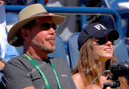 Larry Ellison, Nikita Kahn Oracle CEO Larry Ellison and his girlfriend, Ukranian actress Nikita Kahn, watch Roger Federer, of Switzerland, and Dmitry Tursunov, of Russia, competet during a third round match at the BNP Paribas Open tennis tournament, in Indian Wells, Calif