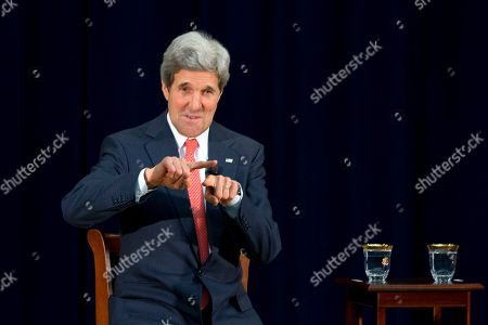 """Stock Image of John Kerry Secretary of State John Kerry, jokingly makes a """"shame on you"""" gesture in response to an audience of college students who incorrectly guessed the percentage of the U.S. budget spent on the State Department and global aid as being 20%, when Richard Stengel, Undersecretary of State for Public Diplomacy responded that it is less than 1%, during a town hall meeting with university students, at the State Department"""