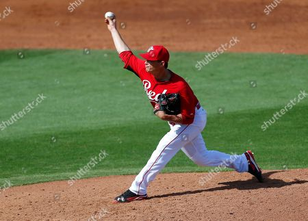 Stock Picture of Chad Rogers Cincinnati Reds pitcher Chad Rogers throws against the Seattle Mariners during an exhibition baseball game in Goodyear, Ariz