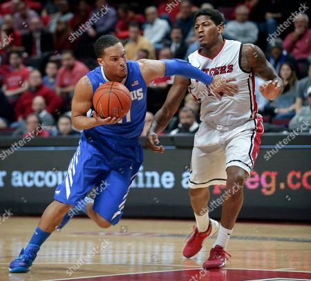 Michael Dixon Jr., Craig Brown Memphis guard Michael Dixon Jr. (11) pushes his way past Rutgers guard Craig Brown (15) on a drive to the basket during the second half of an NCAA college basketball game, in Piscataway, N.J. Dixon had 15 points in Memphis' 64-59 win