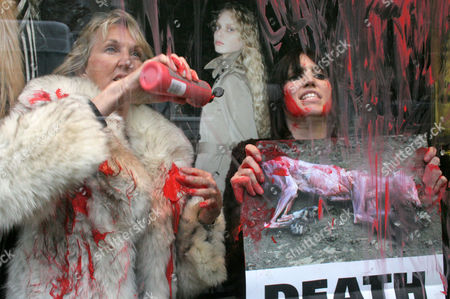 PETA (People for the Ethical Treatment of Animals) protest against the use of fur in fashion in a Jean-Paul Gaultier fashion shop, after spraying red paint on the shop window - Ingrid Newkirk, co-founder and President of PETA (L)