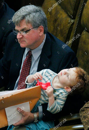 Stock Photo of Kevin Horan, Mary Clayton Horan Rep. Kevin Horan, D-Grenada, has his arms full with mail and his three-year-old daughter Mary Clayton shifting around for a better view of the stained glass ceiling in House Chambers at the Capitol in Jackson, Miss., on . Lawmakers periodically bring their children to the floor to show them what their parent does at the Legislature